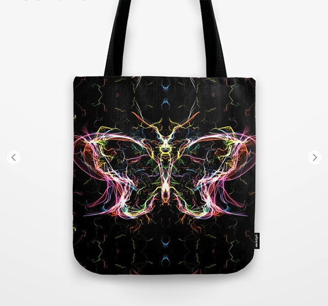 Radiant lighting butterfly Tote Bag by angeldecuir | Society6 http://bit.ly/2jJjHwo